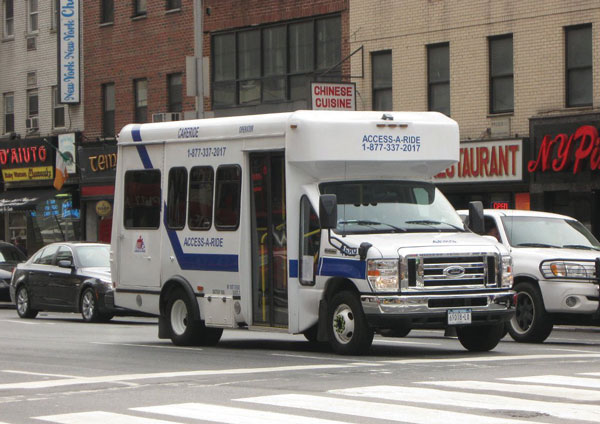 An access-a-ride bus on the road.