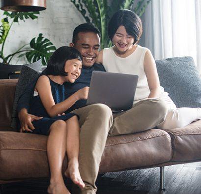 a family at the computer together