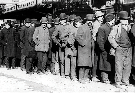 People standing in a bread line during the Great Depression.